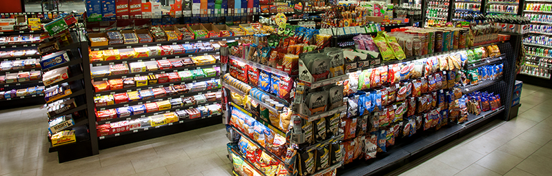 LED lighting installed in merchandising fixtures center aisles in convenience store.